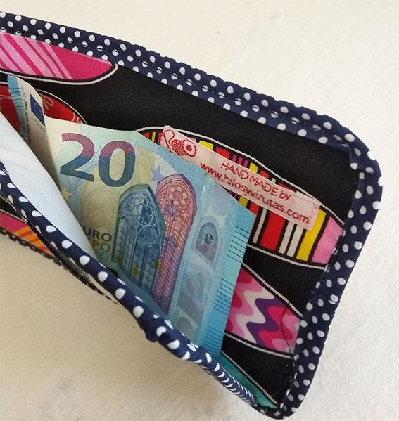 billetera retales con billete surf